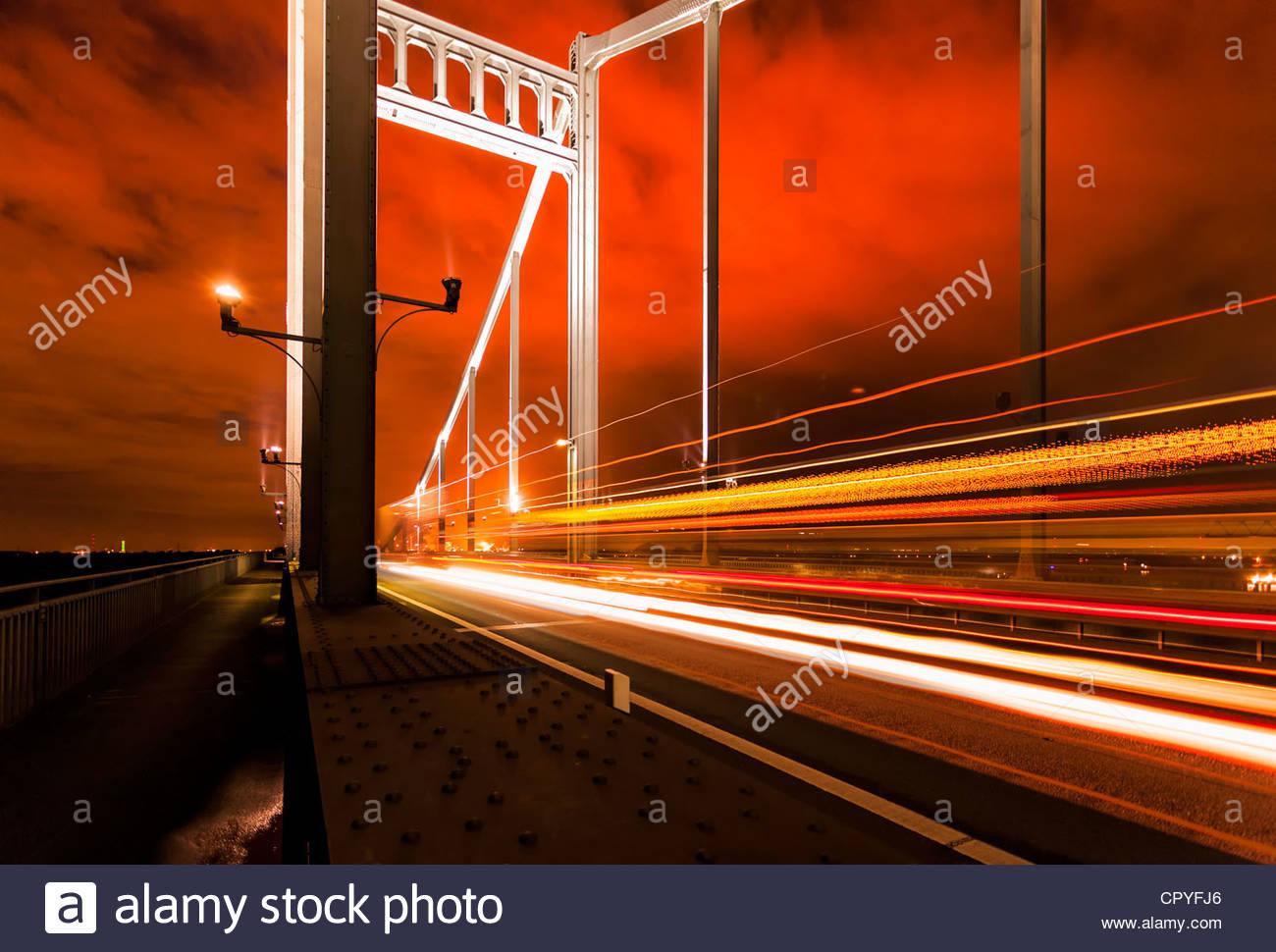 Rhine bridge Krefeld Uerdingen traffic road night light traces steel construction building structure travel Ruhr - Stock Image