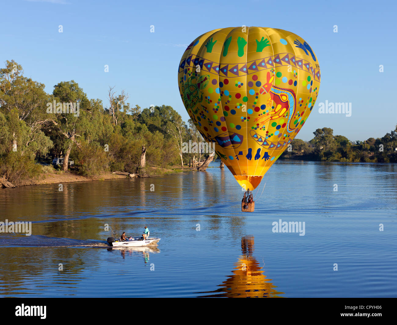 Colorful balloon drifts slowly over the River Murray near Wentworth, NSW, Australia Stock Photo