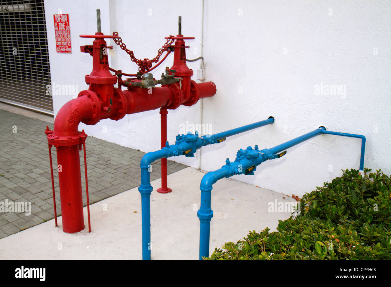 Miami Coral Gables Miami Florida water pipes gas plumbing exposed commercial building Stock Photo