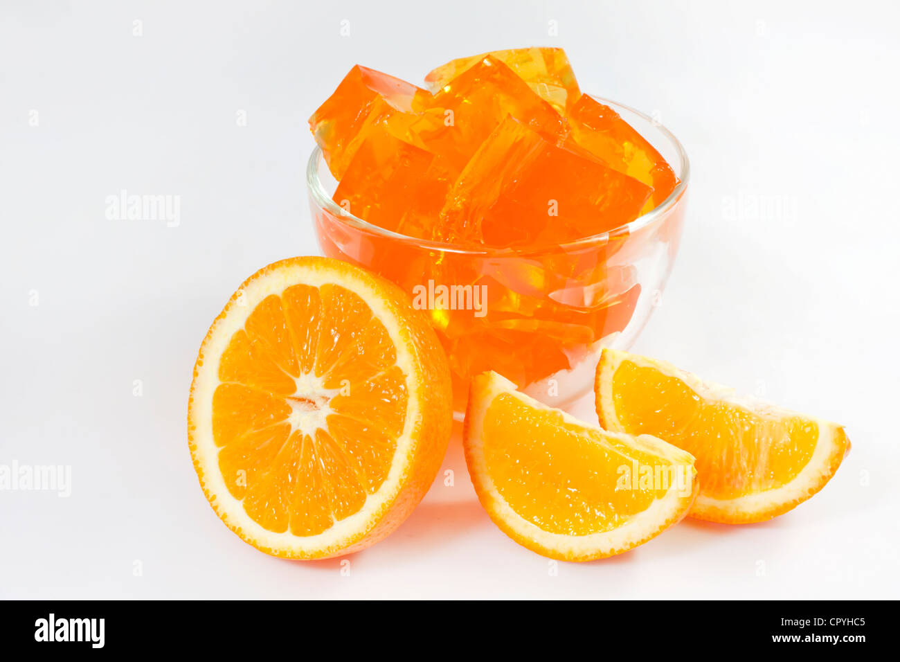 Jelly dessert with oranges on white background - Stock Image