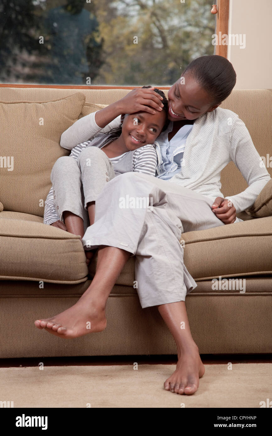 Mother and daughter happily  sitting together, Illovo Family, Johannesburg, South Africa. - Stock Image