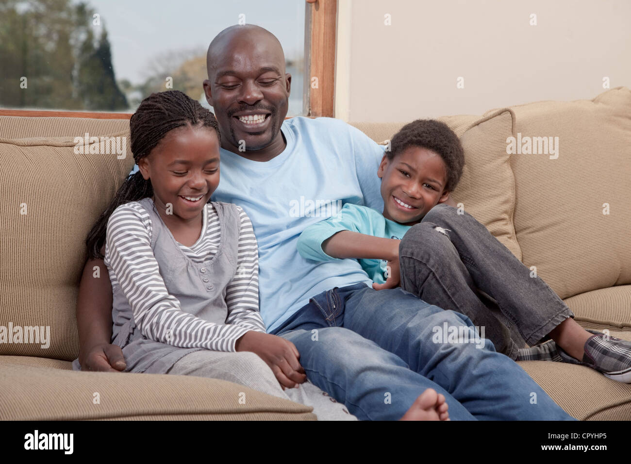Father and children lovingly sitting together, Illovo Family, Johannesburg, South Africa. - Stock Image