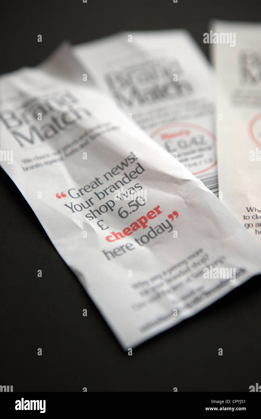 Brand match receipts from Sainsbury's supermarket showing how much you saved shopping in their store and money - Stock Image
