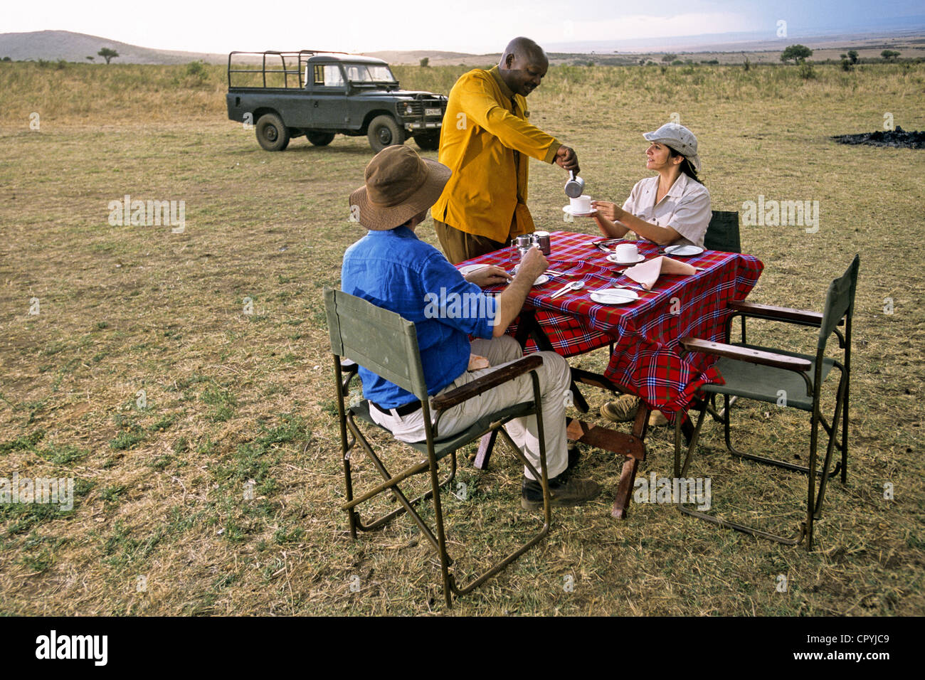Kenya, South-West, Masai Mara Nature Reserve, english breakfast deep in the savannah, Out of Africa style Stock Photo