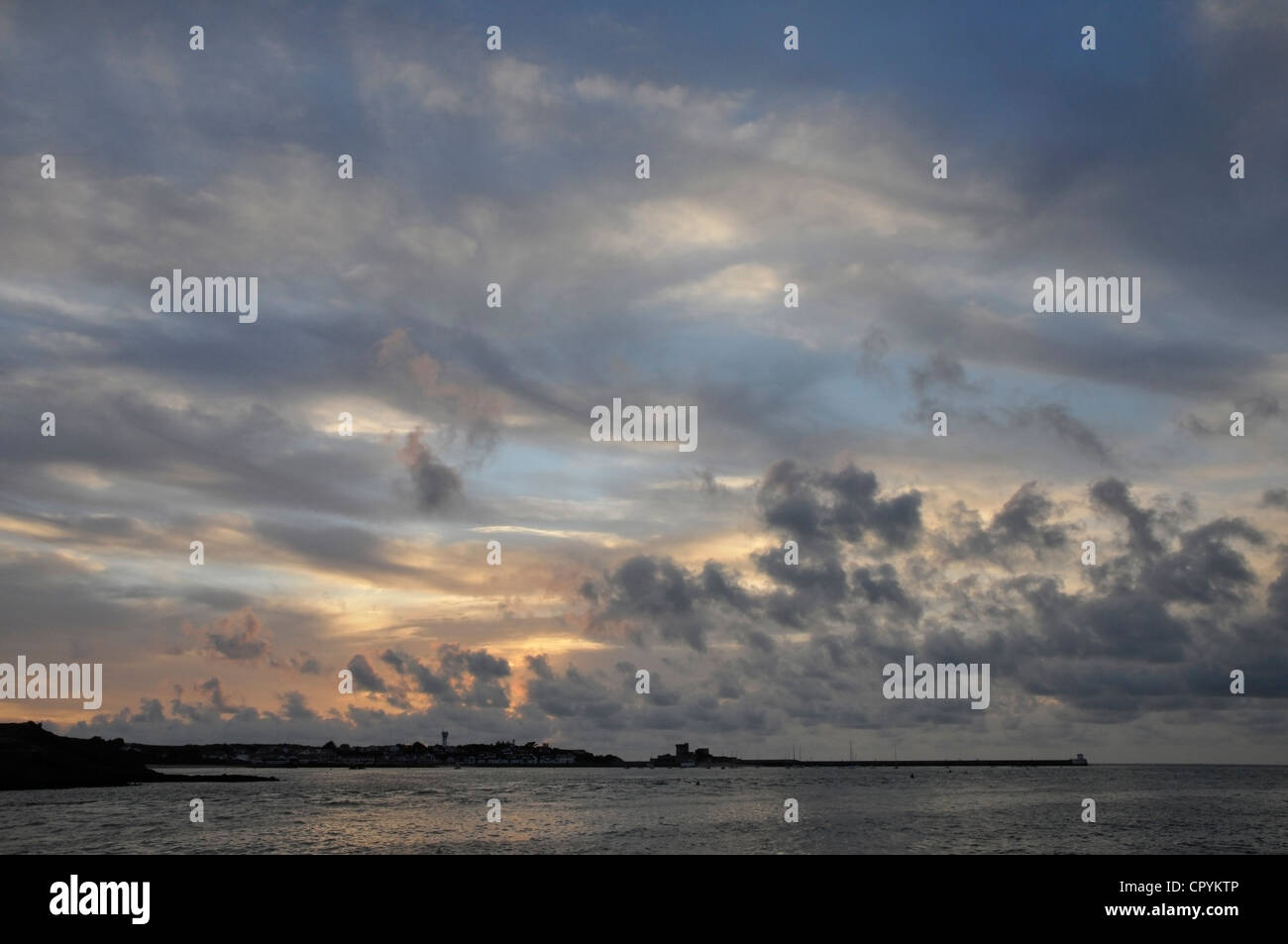 Sunset with a Cloudy Sky above the Sea - Stock Image