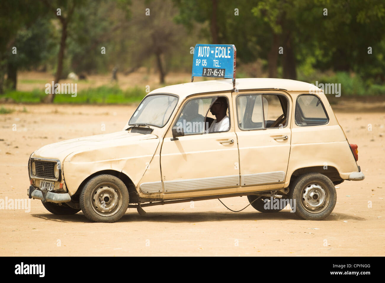 A man takes driving lessons in an open field in N'Djamena, Chad on Tuesday June 8, 2010. - Stock Image