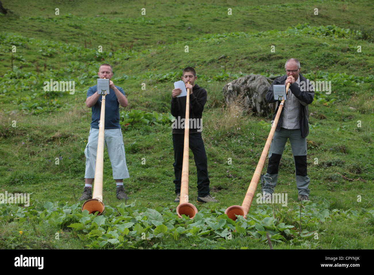 Horn blowers in the French Alps, Doran, Haute-Savoie, France, Europe - Stock Image