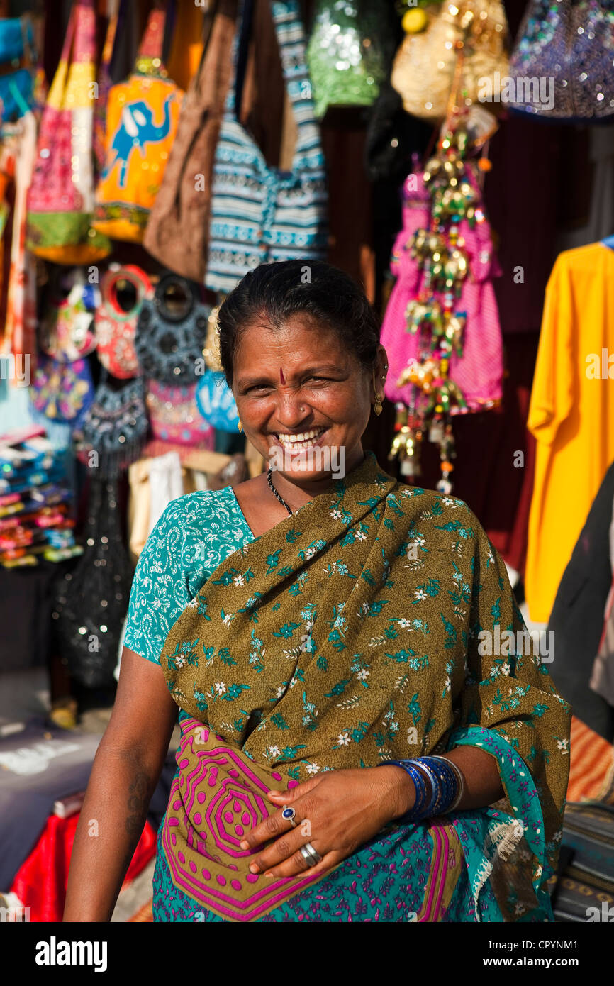 India, Kerala State, seaside resort of Kovalam, shop assistant of a tee-shirt shop on the beach - Stock Image