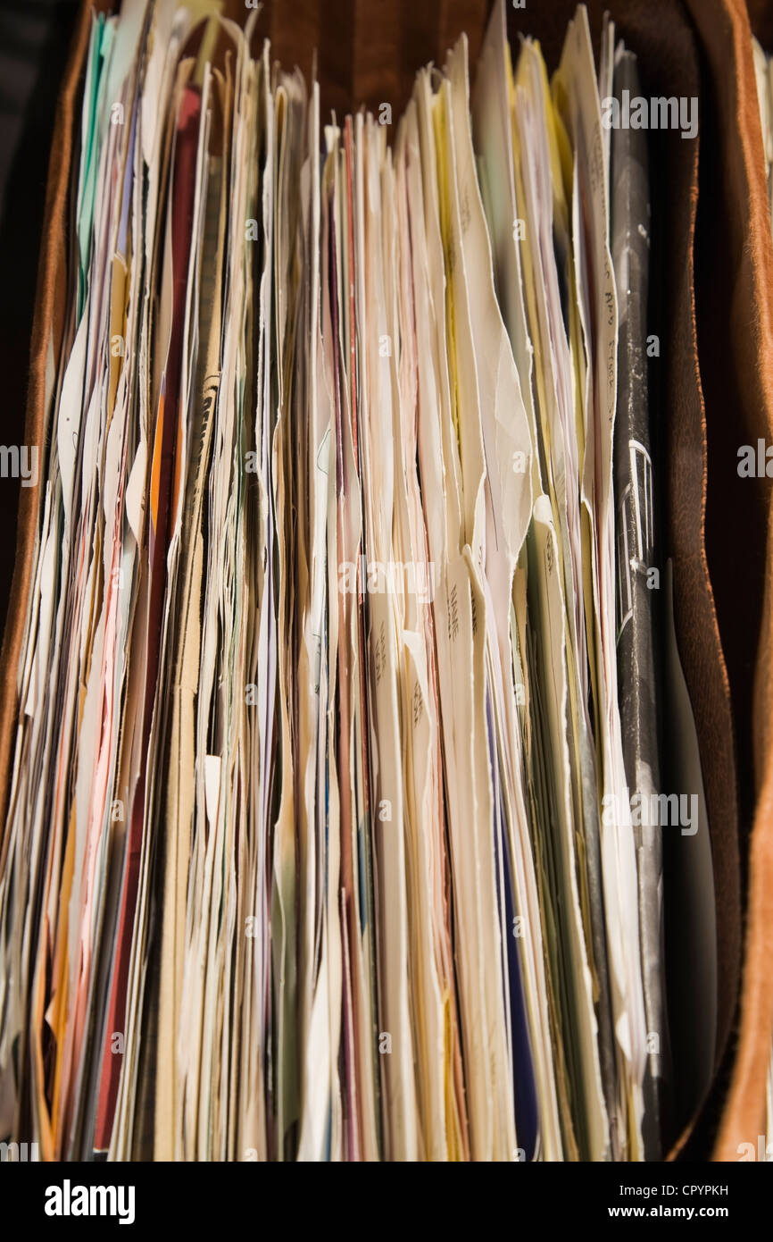 Close-up of folders and documents in a filing cabinet - Stock Image