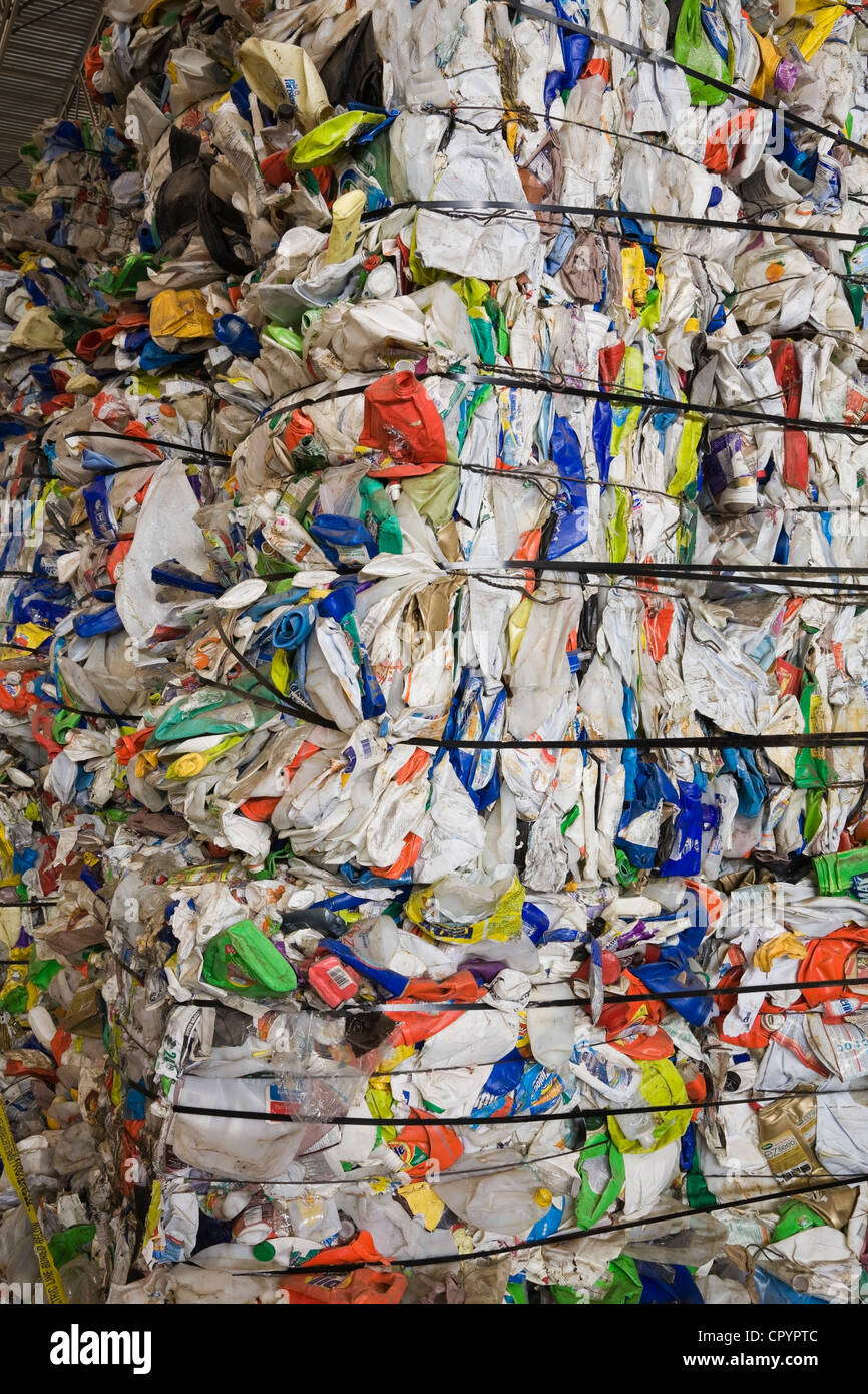 Bales of recyclable plastic containers at a sorting centre, Quebec, Canada - Stock Image