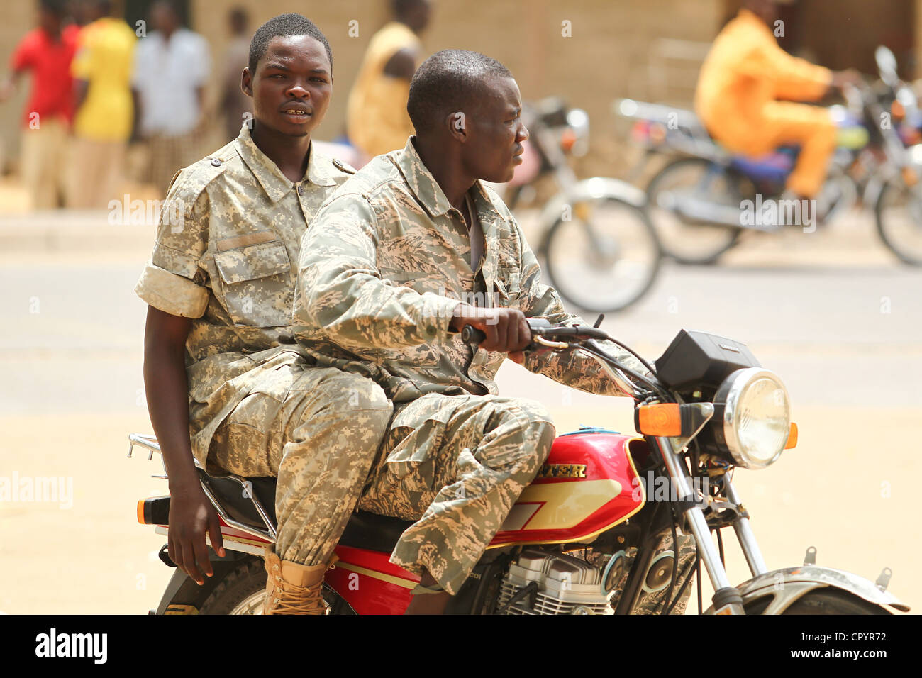 Two soldiers ride a motorcycle in N'Djamena, Chad on Tuesday June 8, 2010. - Stock Image