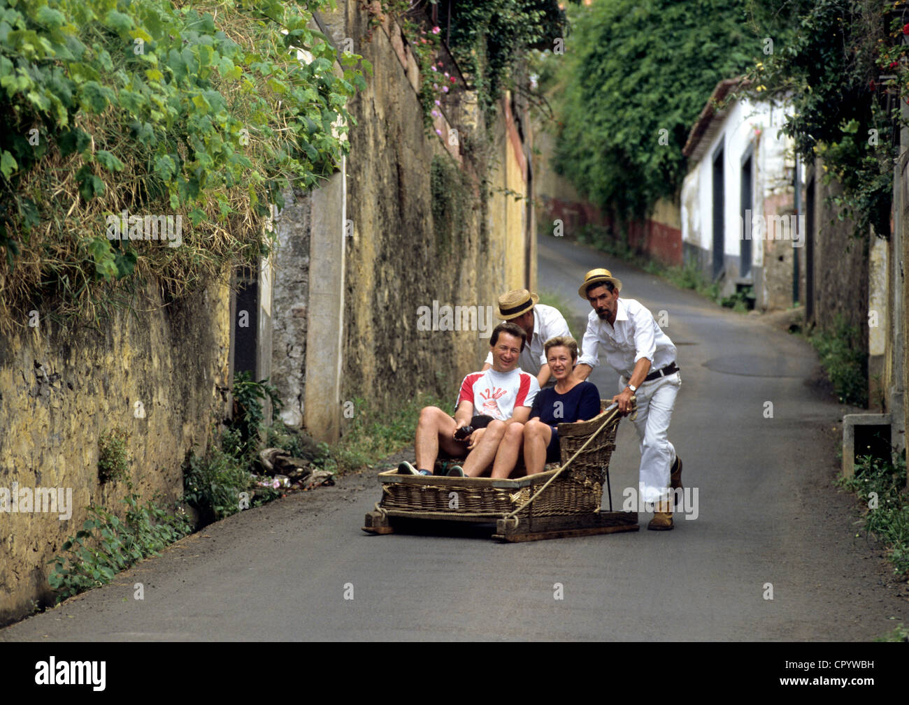 Portugal, Madeira Island, Funchal, playing on a toboggan sledg locally known as Monte - Stock Image