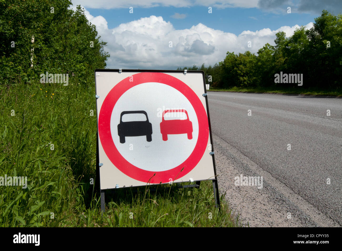 no overtaking warning sign due to loose chippings on newly resurfaced road uk - Stock Image