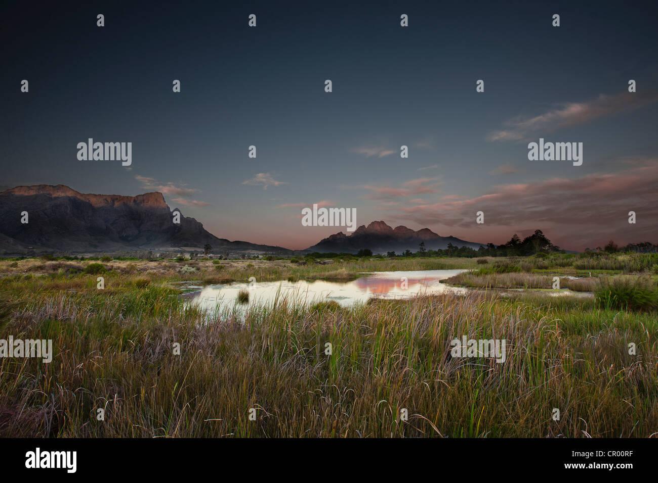 Still lake in rural landscape - Stock Image