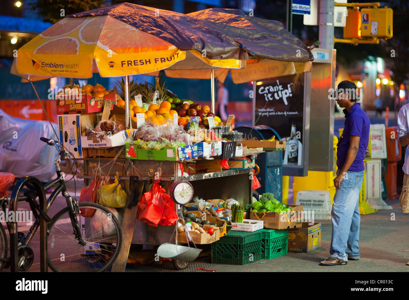 A 24 hour fruit and vegetable stand in the Chelsea neighborhood of New York Stock Photo