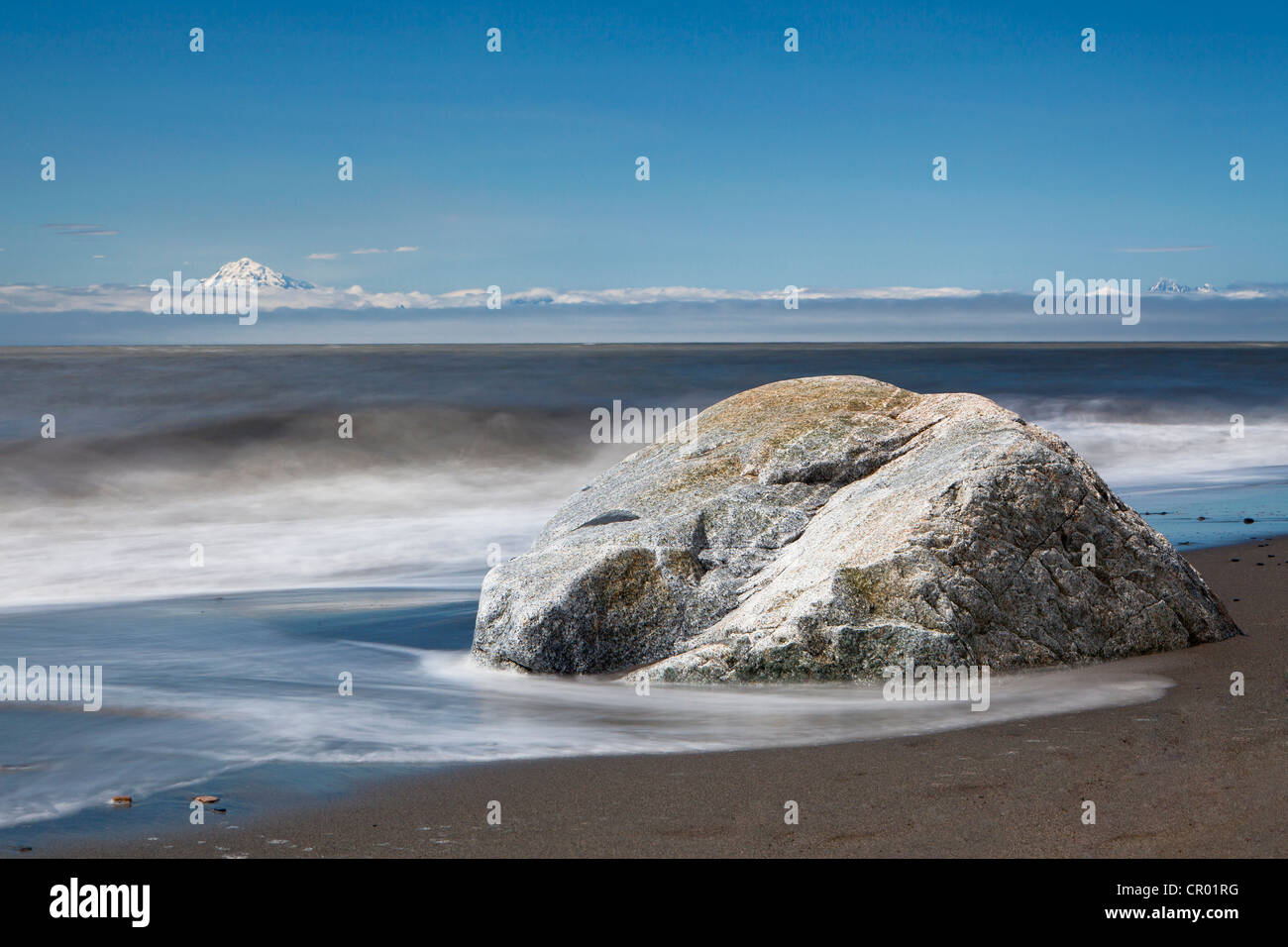 Surf on the beach of Kenai on the Kenai Peninsula with Mount Redoubt volcano, Cook Inlet, Alaska, USA - Stock Image