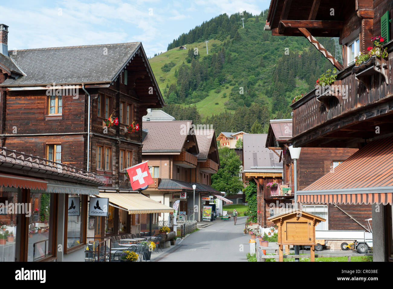 Traditional wooden houses in the main street Uf em Biel, car-free village, Muerren, Walser mountain village in the - Stock Image
