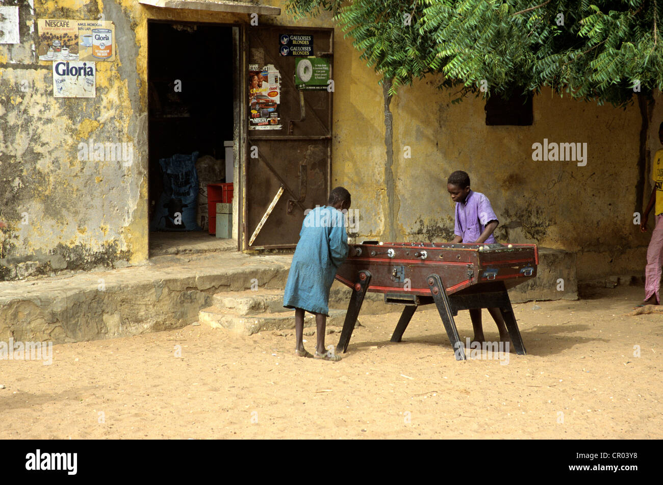 Senegal, children playing table football at M'Bour - Stock Image