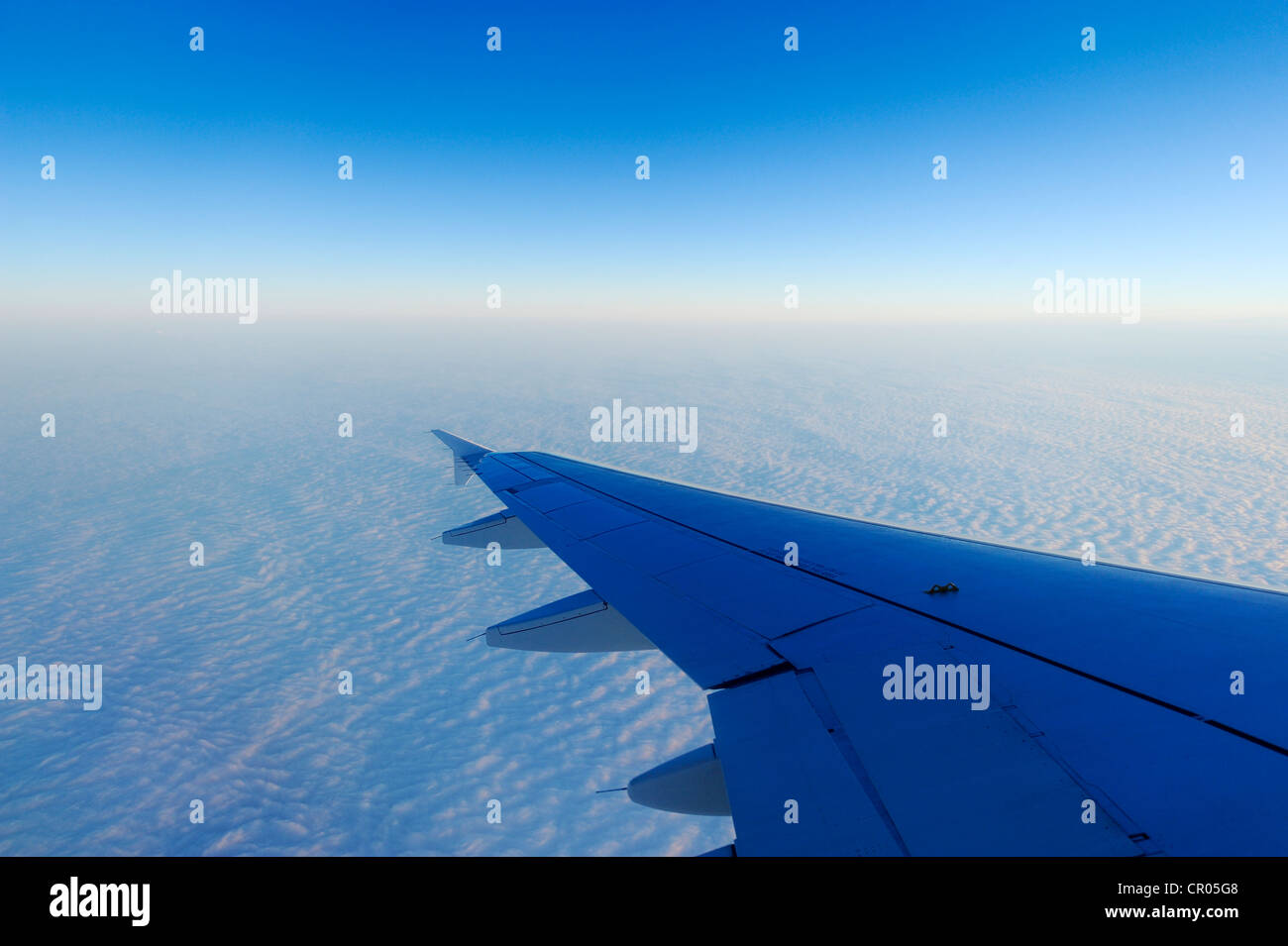 Airplane wings over a sea of fog, Basel, Switzerland, Europe - Stock Image