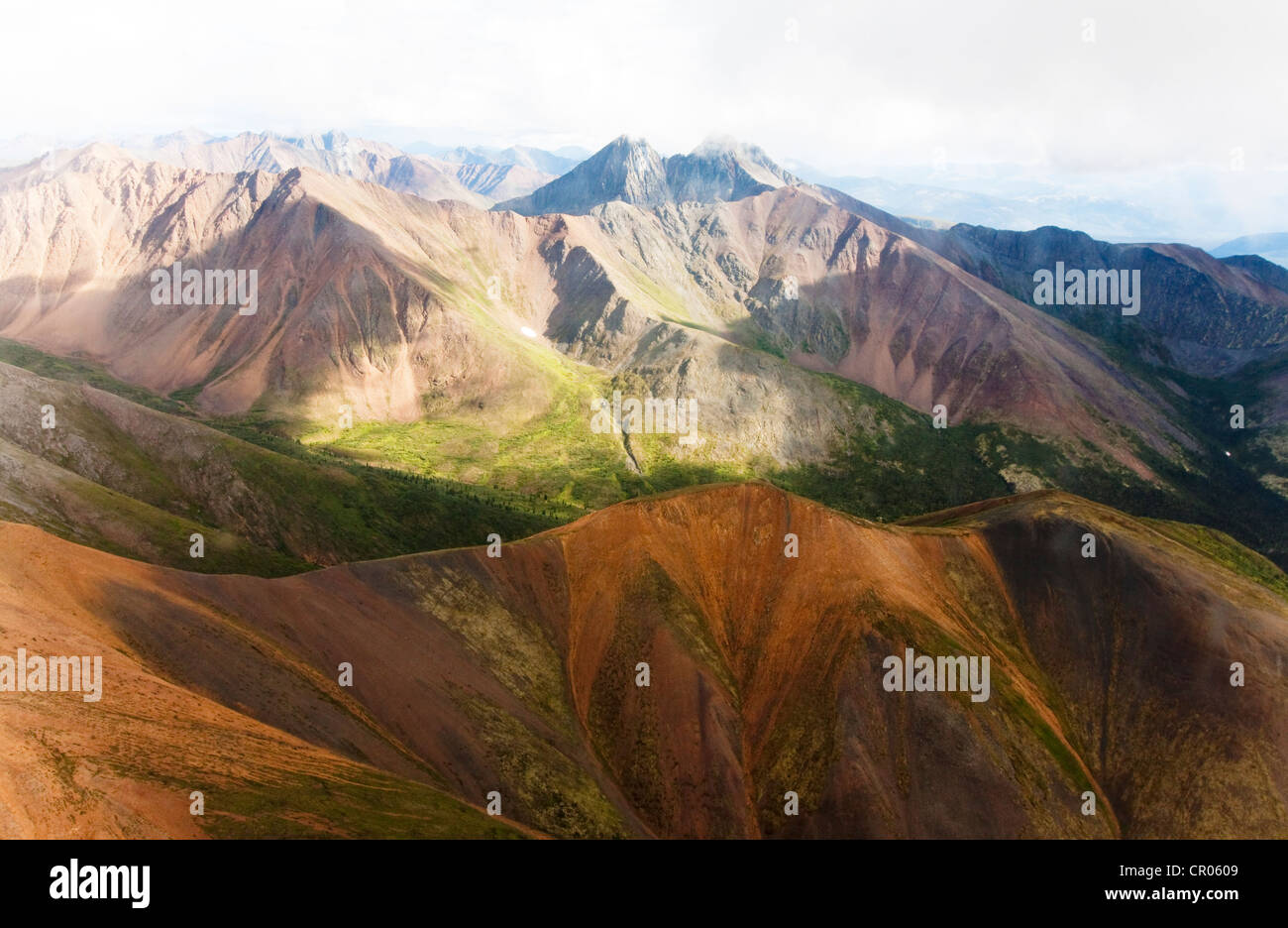 Aerial of mineral-rich Northern Mackenzie Mountains, Peel Watershed, Yukon Territory, Canada - Stock Image