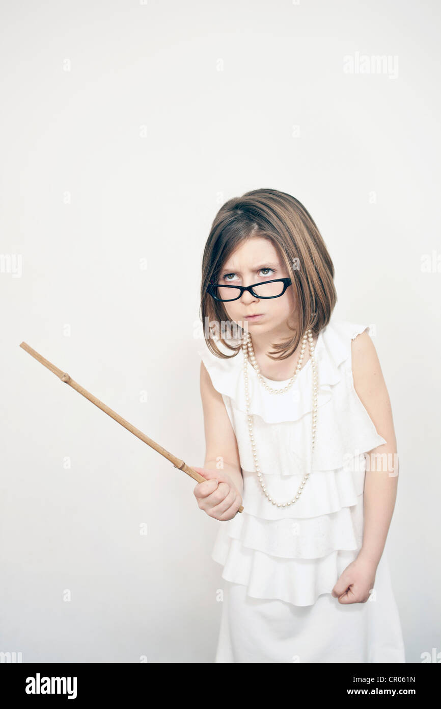 Frowning girl holding stick Stock Photo
