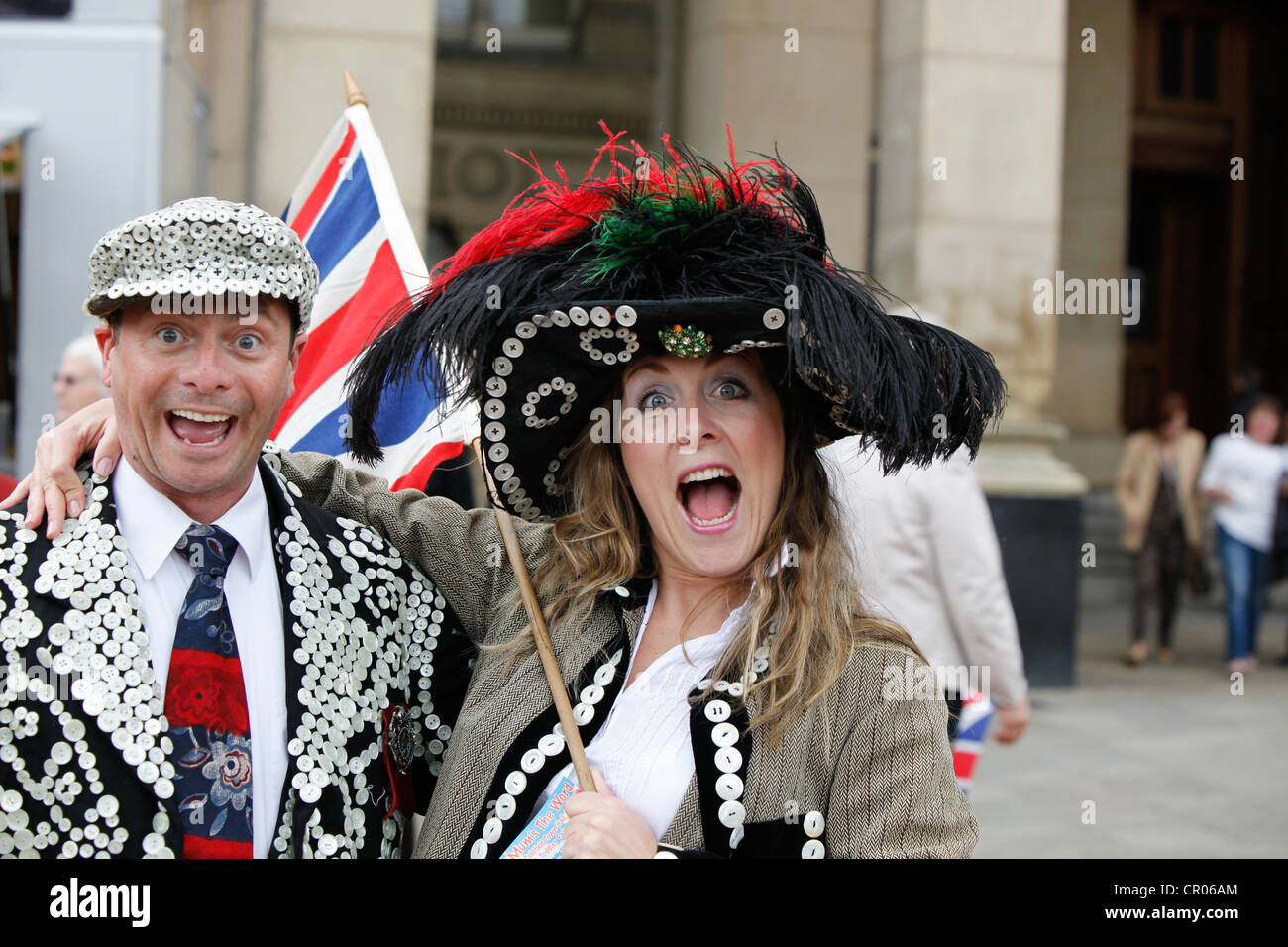 Street entertainers dressed as Pearly King and Queen pose in Birmingham during the Queens Diamond Jubilee celebrations - Stock Image