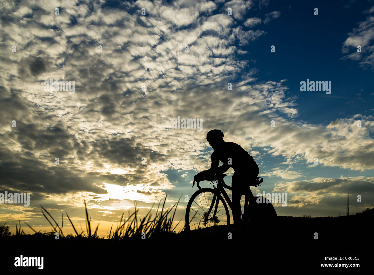 silhouette of a cyclis - Stock Image
