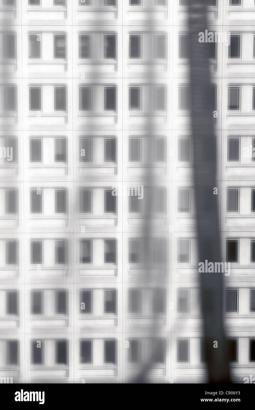 view of a building as seen through net curtains - Stock Image