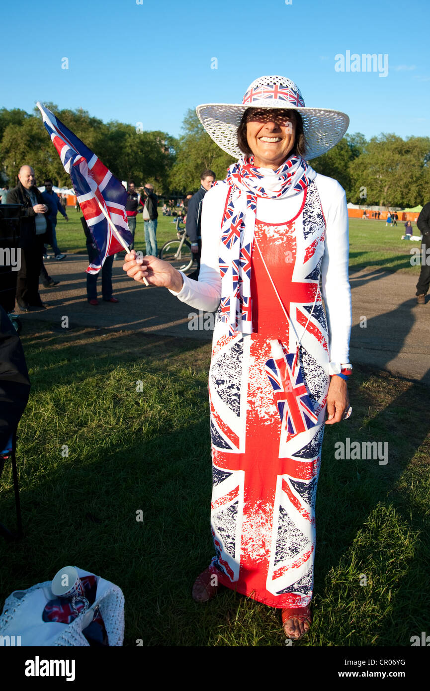 reveller enjoys Queen's Diamond Jubilee celebrations in Hyde Park were big screens were set up - Stock Image