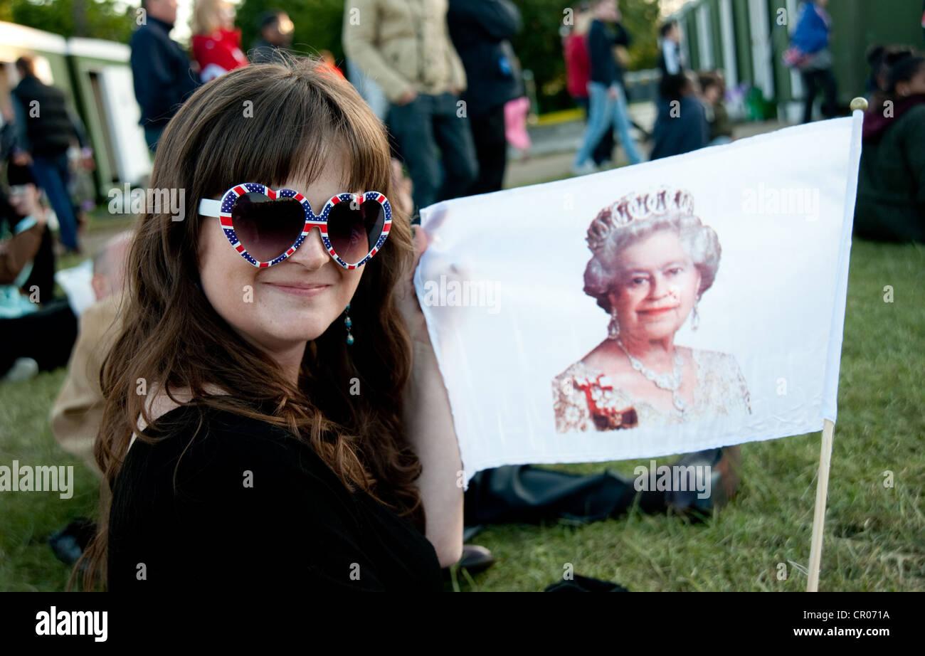 reveller enjoying Queen's Diamond Jubilee festivities in Hyde Park were big screen were set up - Stock Image