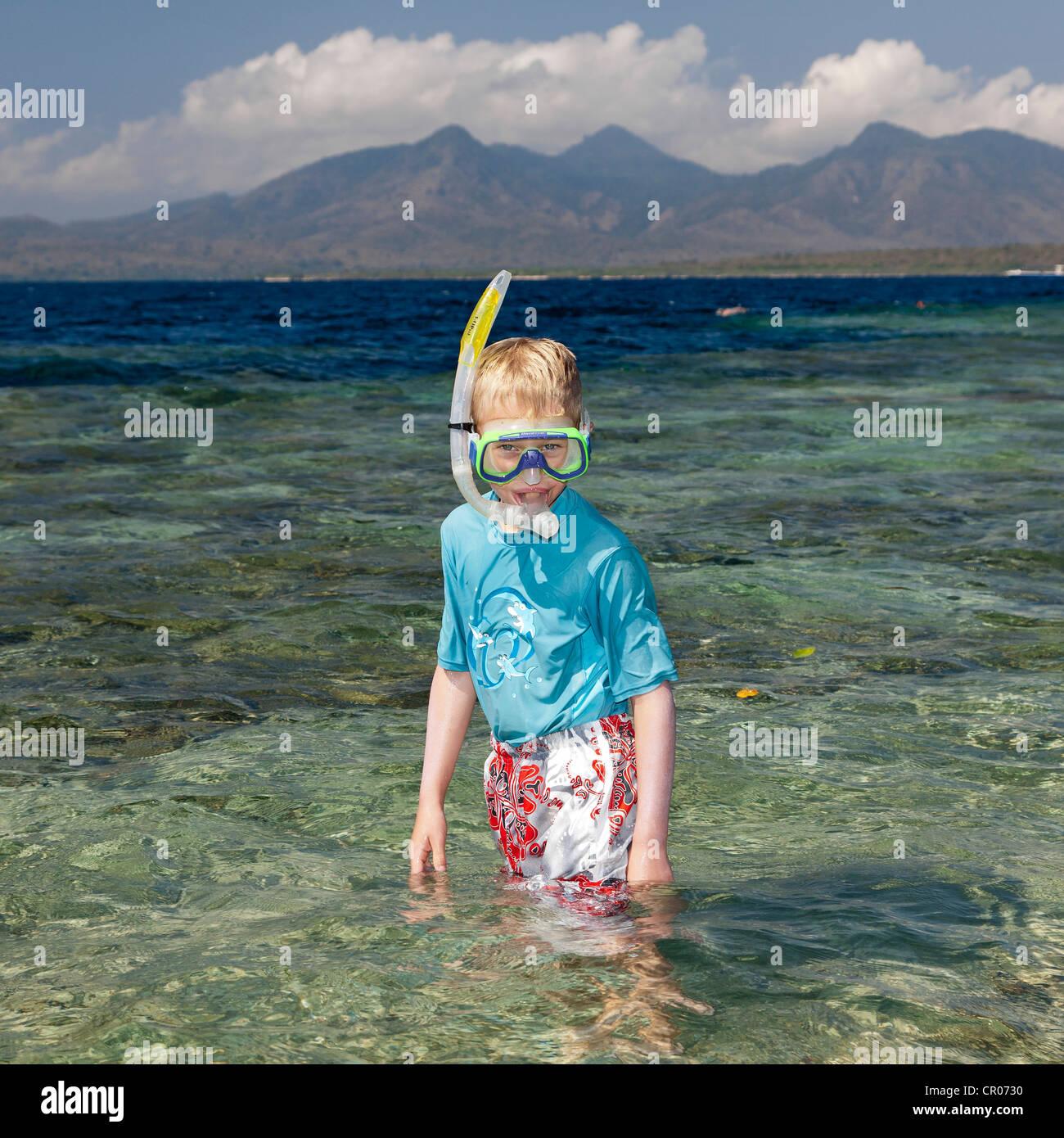 Boy wearing diving goggles and a snorkel, Menjangan Island, West Bali, Bali, Indonesia, Southeast Asia, Asia - Stock Image