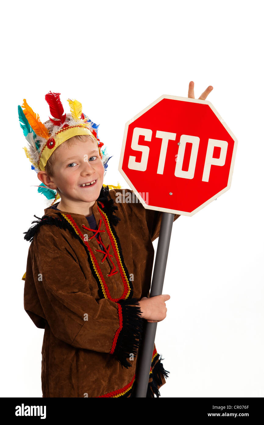 A boy, 7 years, wearing American Indian fancy dress, with stop sign Stock Photo
