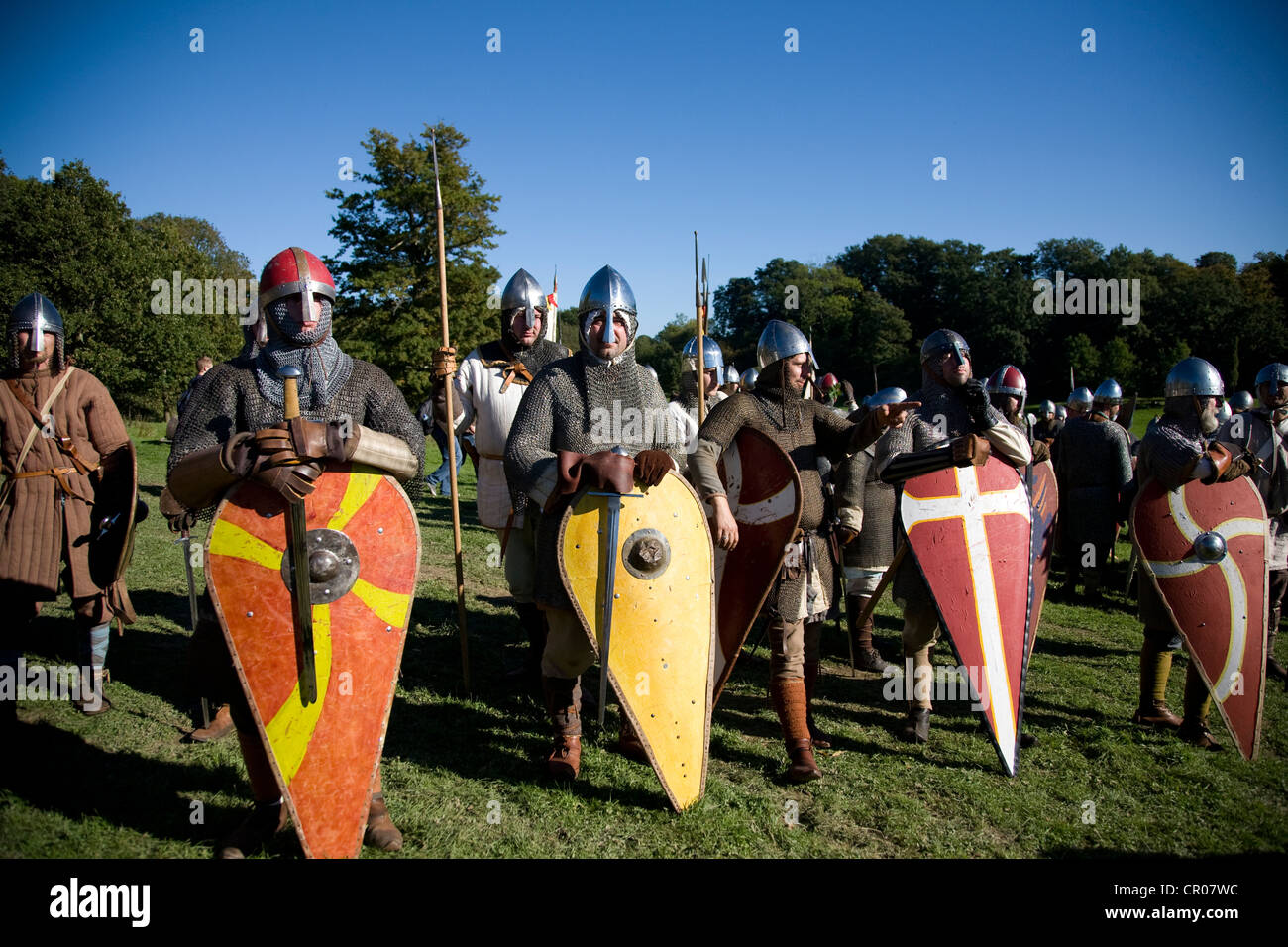 UK. England. Reenactment of 1066 Battle of Hastings. East Sussex. Men in chainmail with shields. - Stock Image