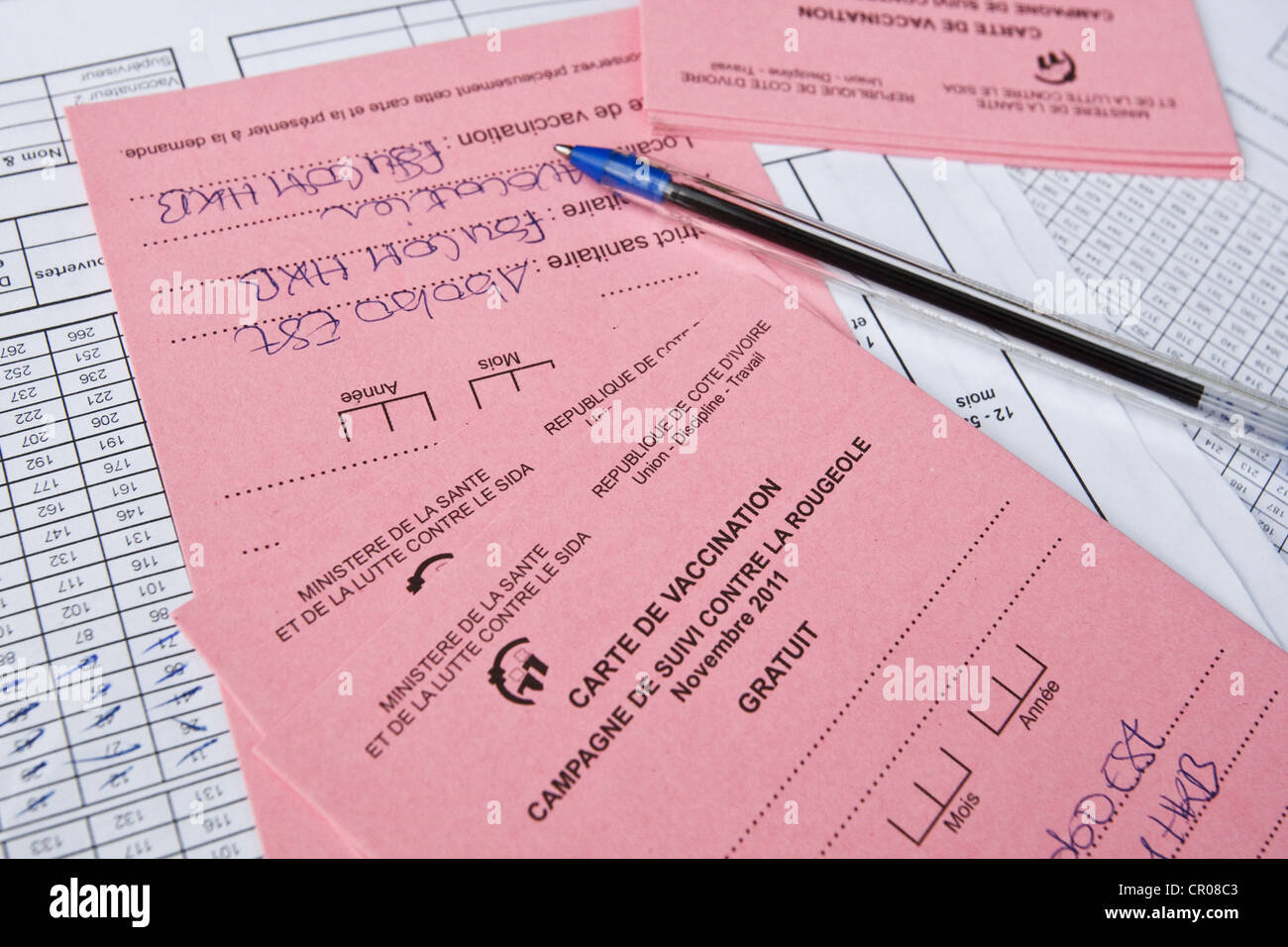 Measles vaccination cards during a national vaccination campaign at the Henriette Konan Bedie Community hospital - Stock Image
