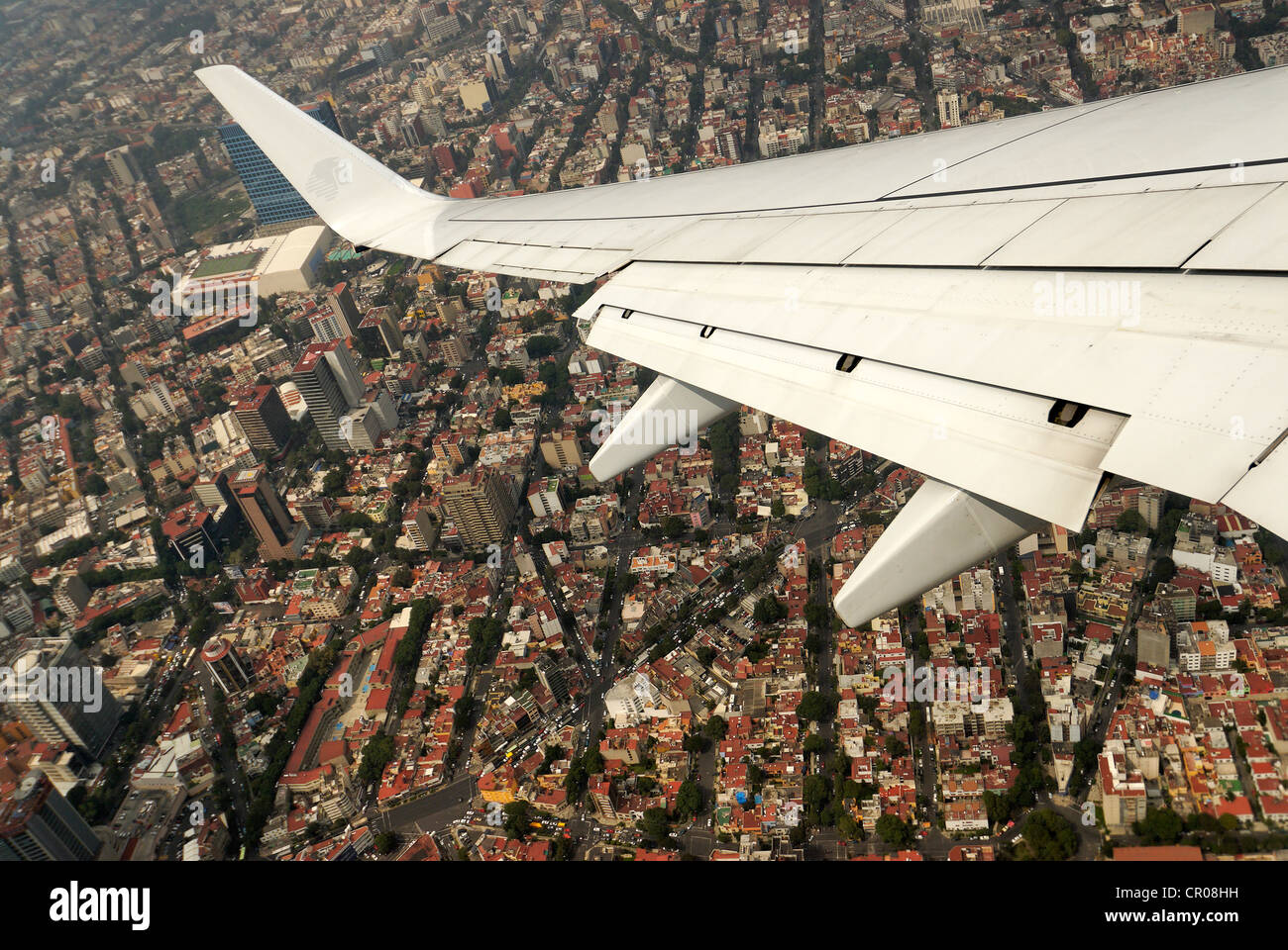 Mexico, District Federal, Mexico, flying over the Caiptal soon before landing at International Benito Juarez airport - Stock Image