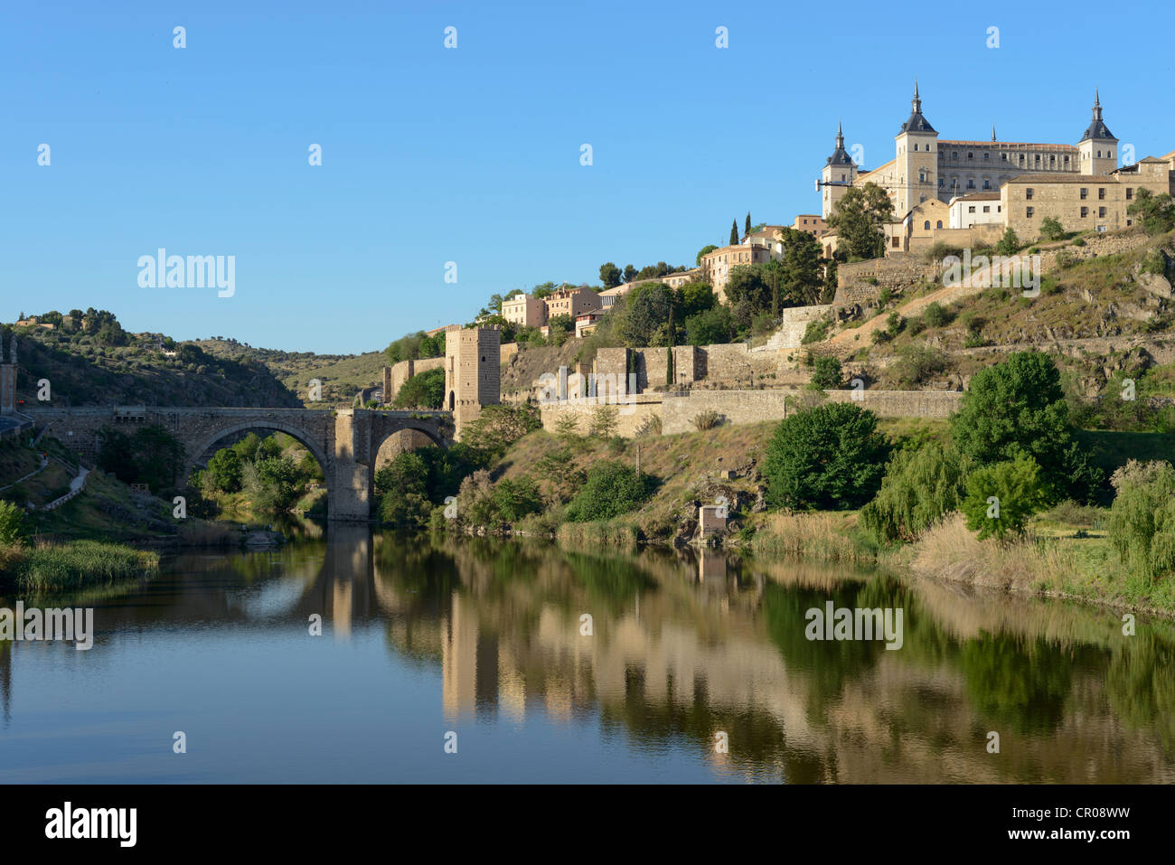 Tagus River with San Martin Bridge and the Alcazar, Toledo,Spain - Stock Image