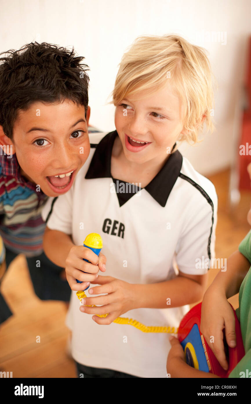 Boys playing together indoors - Stock Image