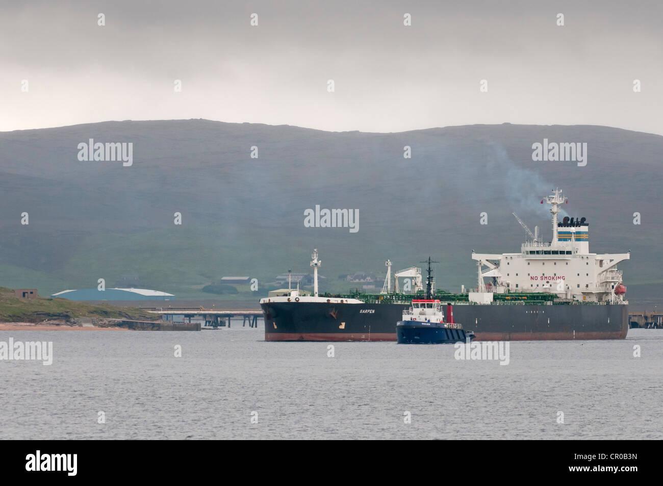Oil tanker Sarpen and pilot boat Shalder negotiating Sullom Voe in the Shetland Islands. June 2010. - Stock Image