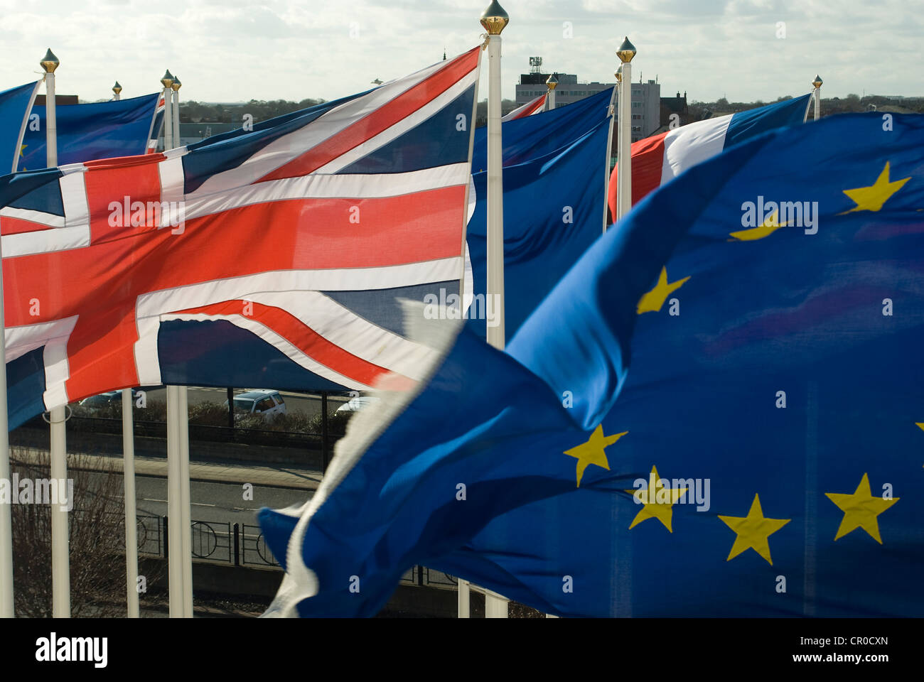 Union Jack and European Union flags flying on numerous flag poles - Stock Image