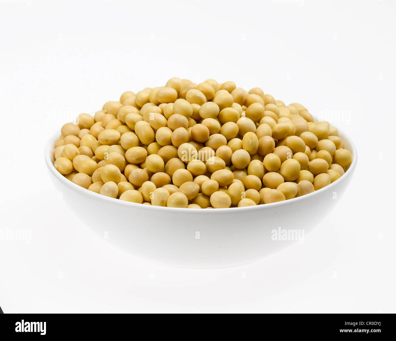 yellow soybeans in bowl - Stock Image