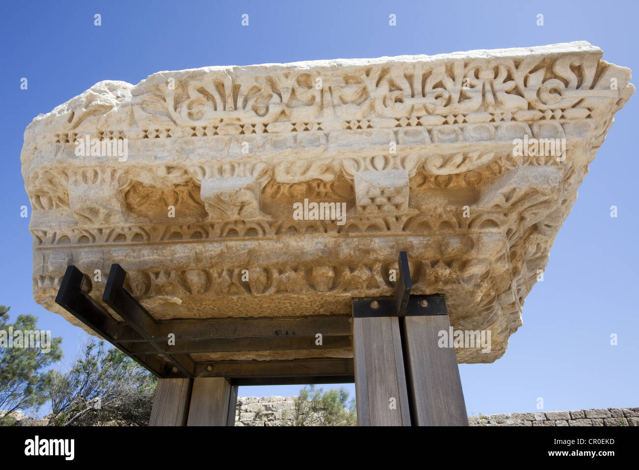 Architectural artifact showing the ornamentation of a cornice and gable at historic Caesarea Maritima, Israel - Stock Image
