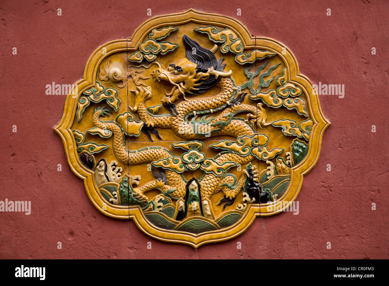 A traditional glazed ceramic wall motif decorates a wall in the Forbidden City  Beijing, People's Republic of - Stock Image