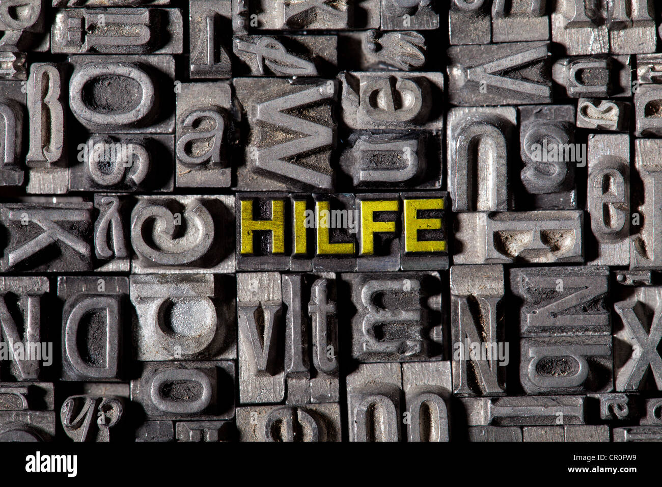The word 'Hilfe', German for 'help', made of old lead type - Stock Image