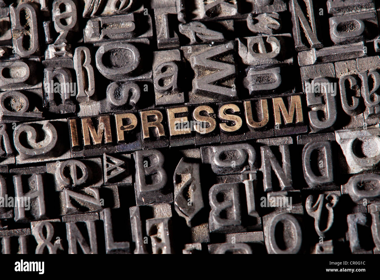The word 'Impressum', German for 'imprint', made of old lead type - Stock Image