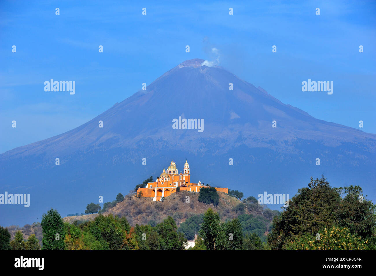 Church of Iglesia Nuestra Senora de los Remedios on the ruins of the pre-Hispanic Pyramid of Cholula in front of - Stock Image