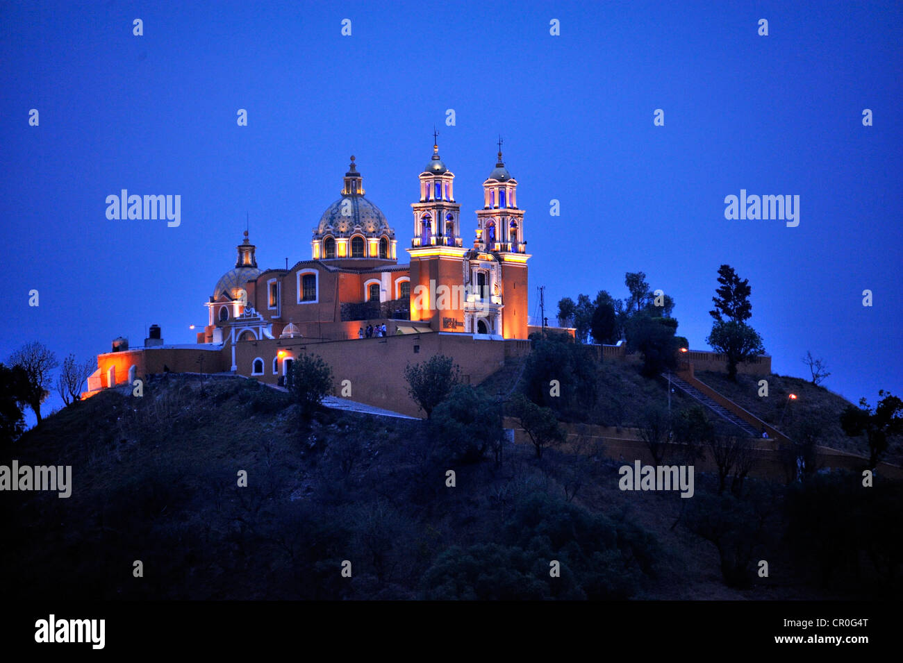 Church of Iglesia Nuestra Senora de los Remedios on the ruins of the pre-Hispanic Pyramid of Cholula at night, , - Stock Image