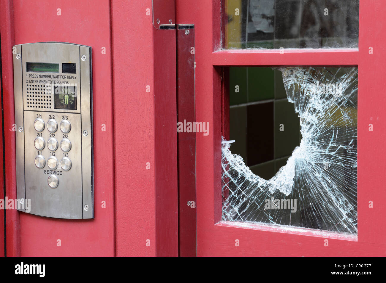 A broken window in a domestic door entry security system in Glasgow city centre, Scotland, UK - Stock Image
