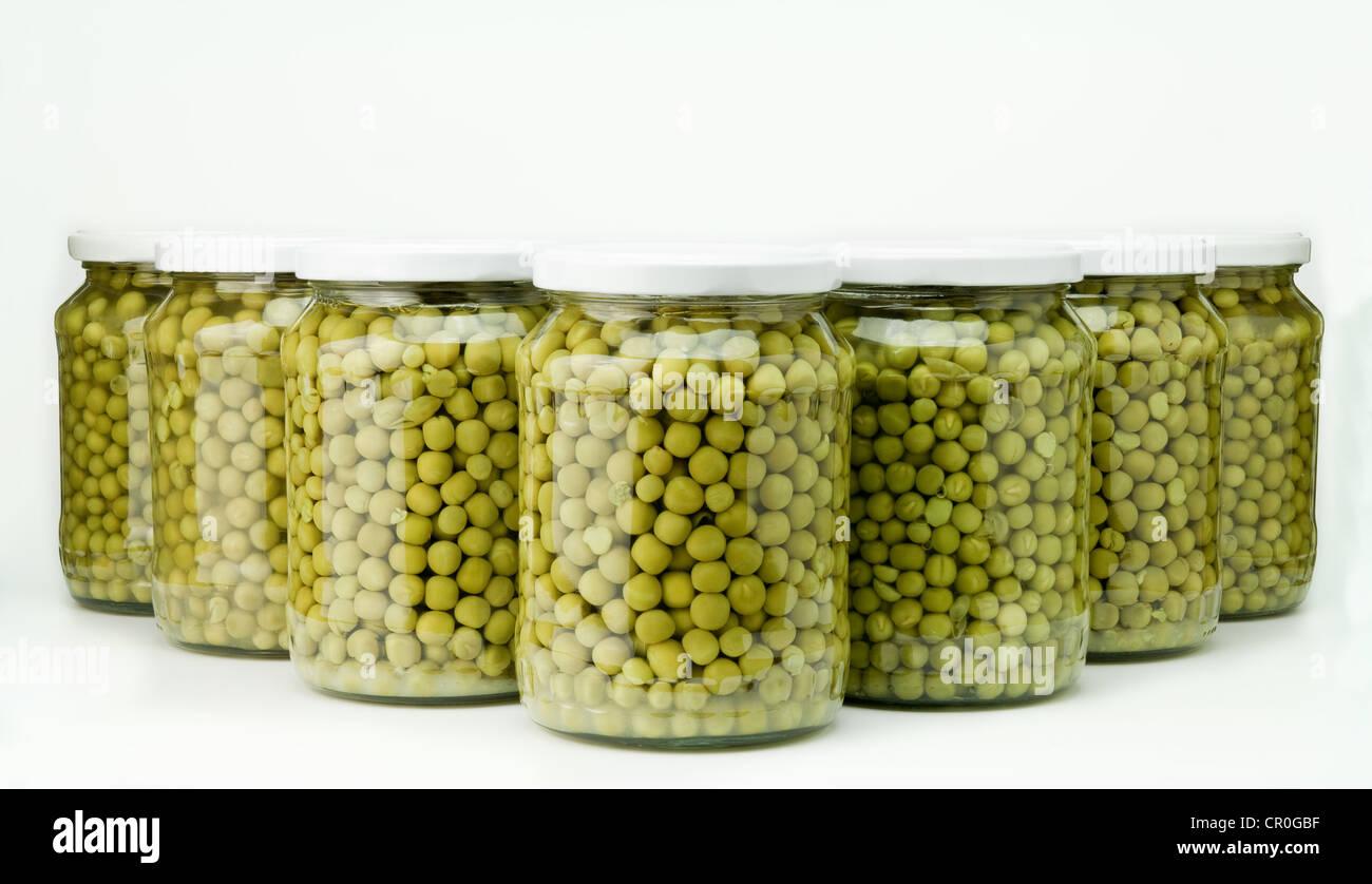 Jars of preserved green peas - Stock Image