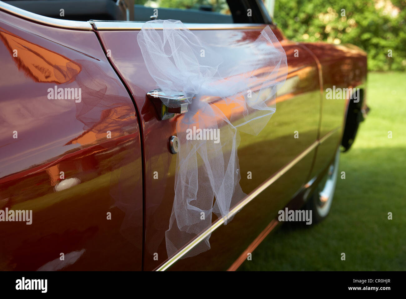 Tulle netting, veil tied to a Cadillac, wedding Stock Photo