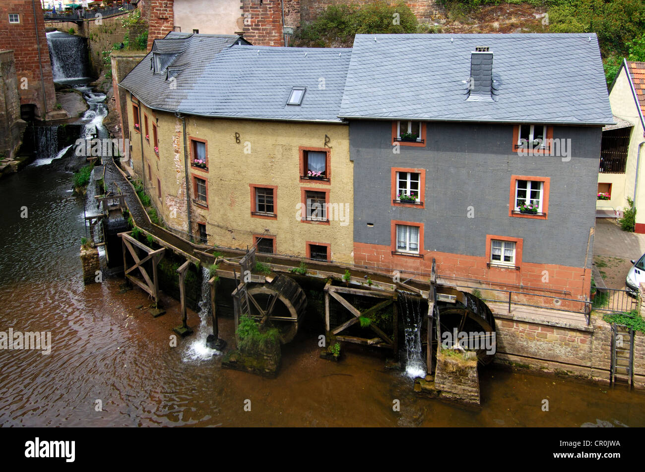 Mill museum Hackenberger Muehle, water mill complex of three staggered mills, Saarburg, Rhineland-Palatinate, Germany, - Stock Image